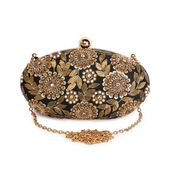 Oval intricate hand embroidered clutch