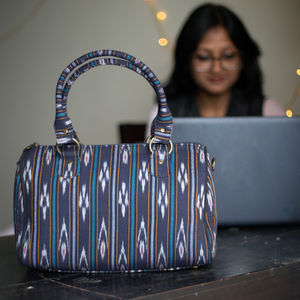 Navy blue and white ikat duffle bag