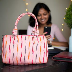 Peach Pink with multicolored pattern Ikat duffle bag
