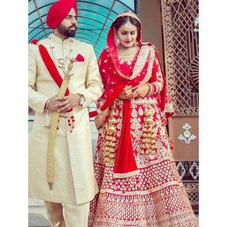 Red Boat Neck Punjabi Style Heavy Bridal Lehenga Choli with Dupatta