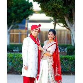 Off White & Red Panel Style Lehenga Choli