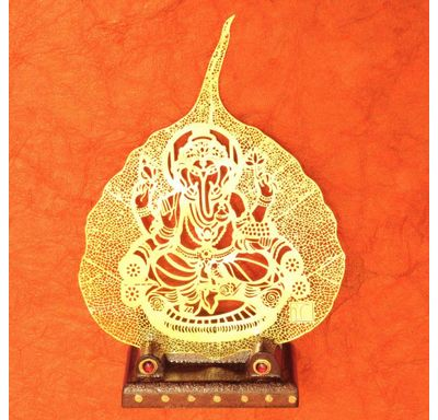 Gold plated leaf Ganesha with singhasana