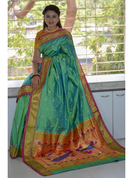 Goldenish Light Green Dhoop Chhaon Traditional Narali Border Peacock Designed Woven Pure Silk Paithani Saree