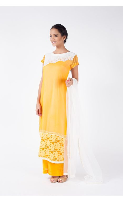 MUSTARD YELLOW EMBROIDERED SHIRT WITH SHARARA PANT ALONG WITH WHITE DUPATTA.
