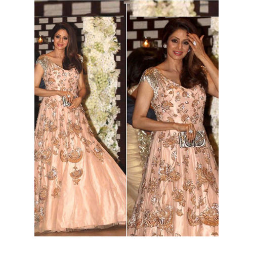 Peach and golden flouncy Gown