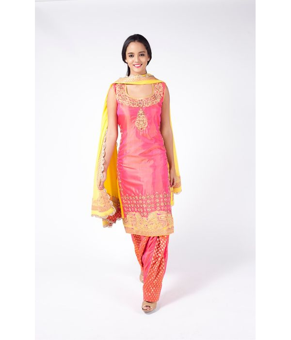 PEACH EMBROIDERED SHIRT WITH  BROCADE JM SALWAR ALONG WITH CHROME YELLOW  DUPATTA.