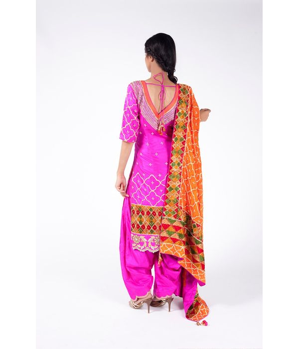 BRIGHT NEON PINK EMBROIDERED SHIRT WITH  JM SALWAR ALONG WITH AMAZON ORANGE DUPATTA.