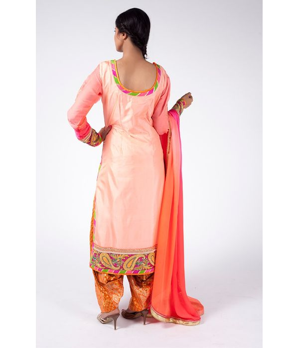 PEACH OMBRE EMBROIDERED SHIRT WITH FESTIVE ORANGE JM SALWAR ALONG WITH PEACH OMBRE DUPATTA.