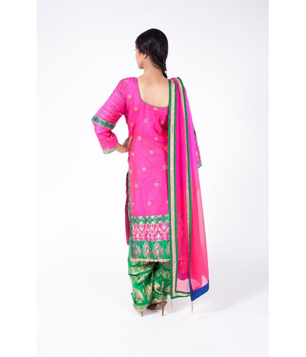 INDIAN PINK AND GREEN EMBROIDERED SHIRT WITH GREEN JM SALWAR ALONG WITH INDIAN PINK DUPATTA.