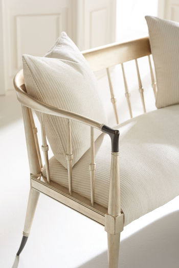 """Settee, 56""""W, Elegant Curved frame & back, metal accents, feather down pillows, cream upholstery."""