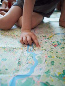 Boy pointing at London National Park City Map