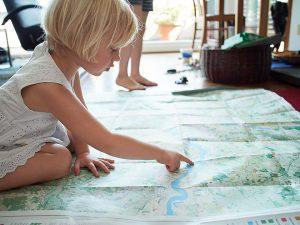 Girl looking at London National Park City Map