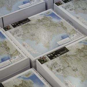 Printed maps in a pile