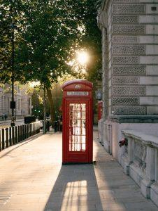 Red telephone box in the morning sun Quiet walks in the city