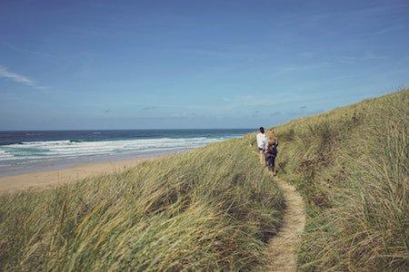 A walk on the beach - people walking in the dunes