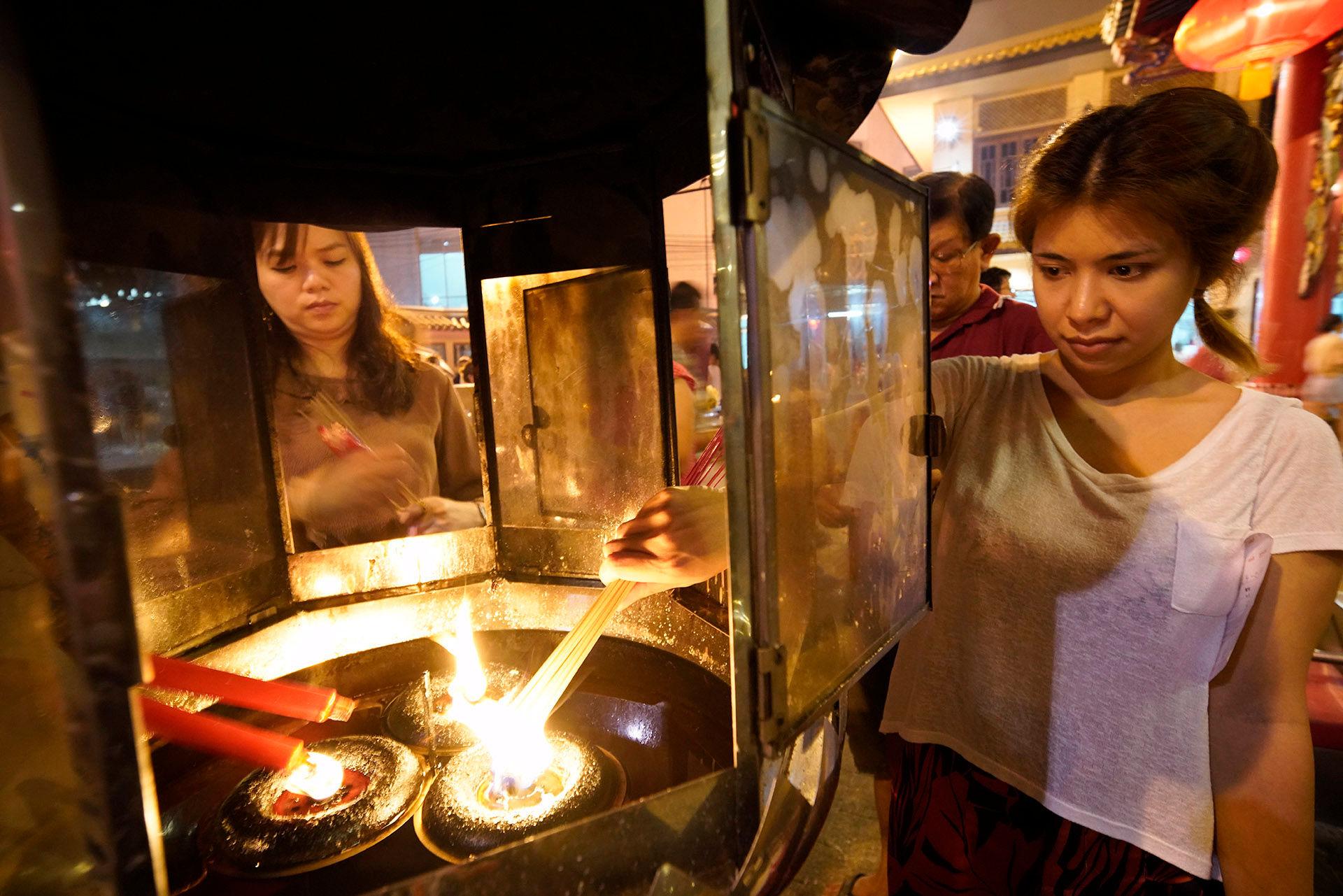 Two Women Lighting Lantern, Chinese New Year