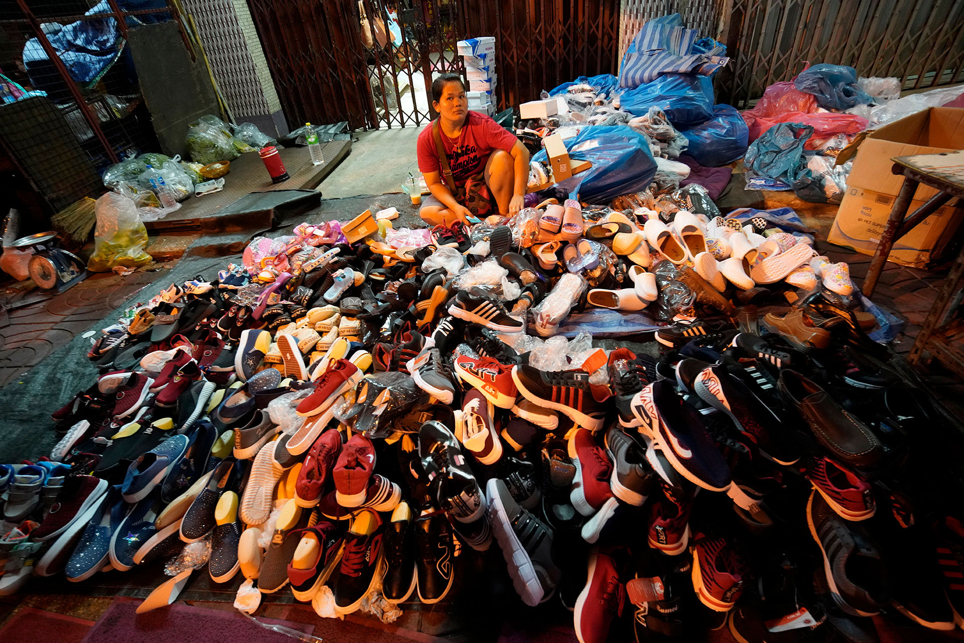 Woman with Shoe Pile