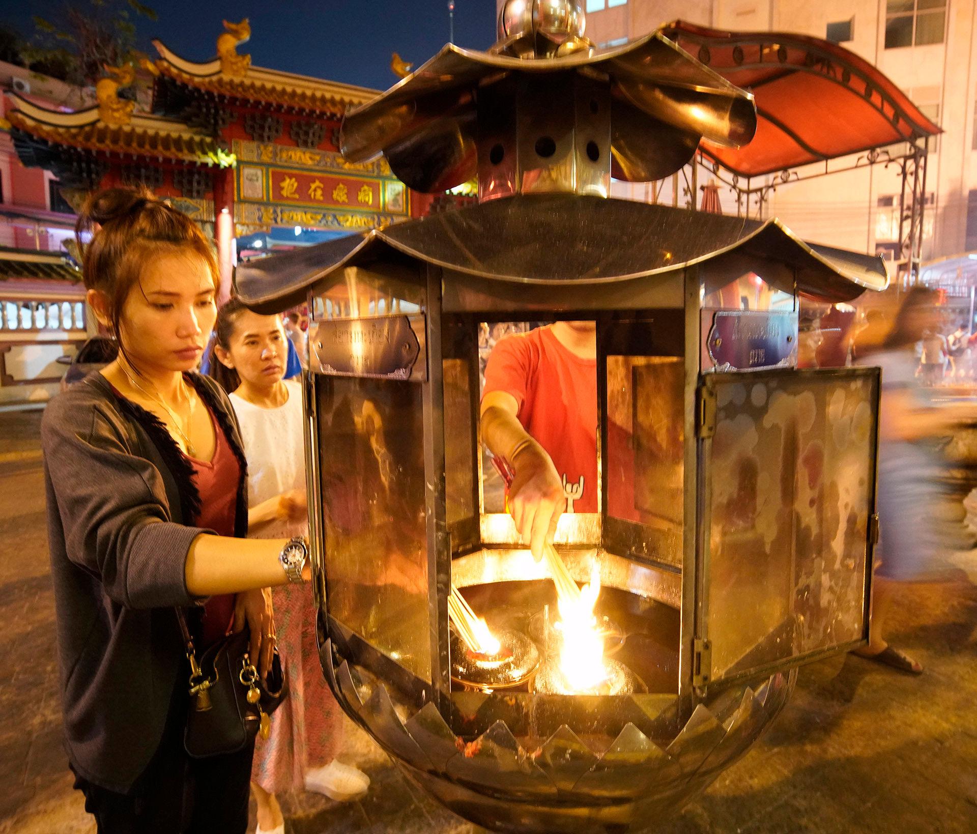 Young Woman Lighting Lantern, Chinese New Year