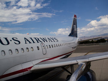 US Airways and American settle with Department of Justice, merger's back on track