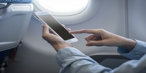 Airline passengers on wifi, in-flight entertainment and on-board activities