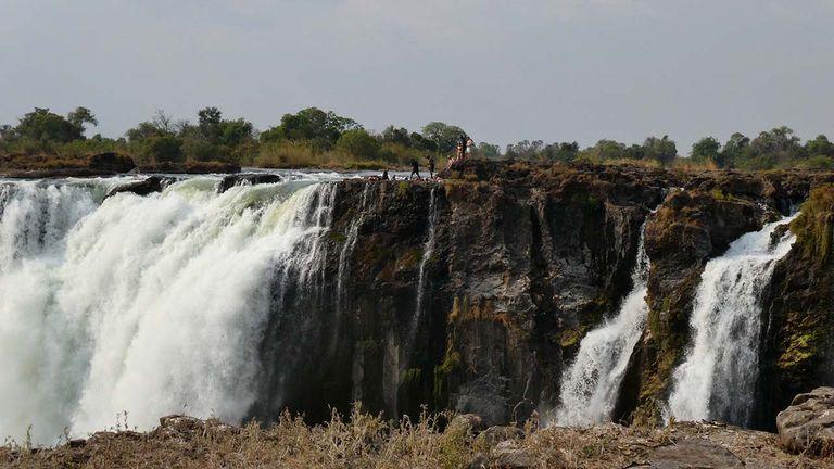 Devil's Pool is a natural rock swimming pool atop Victoria Falls.