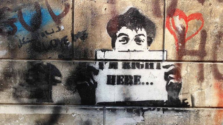 This stencil art of a young boy may express the artist's political opinions.