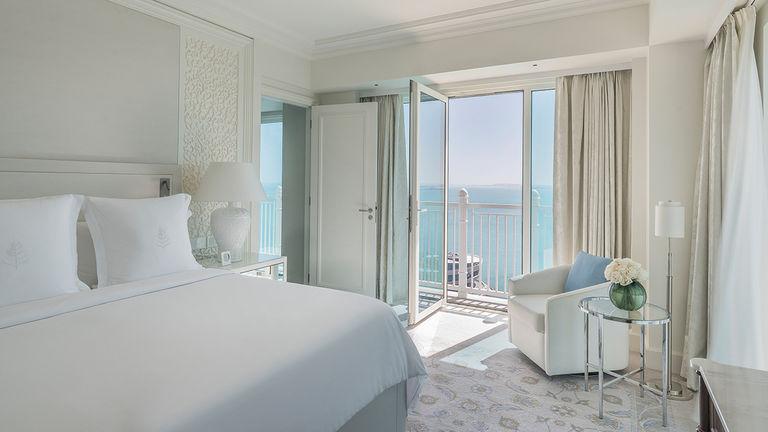 A sea-view guestroom faces the Arabian Gulf.