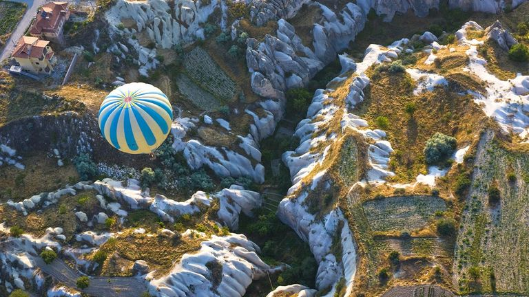 Hot-air balloon rides are must do for visitors traveling to Turkey's Cappadocia region, known for its lunar-like landscapes.