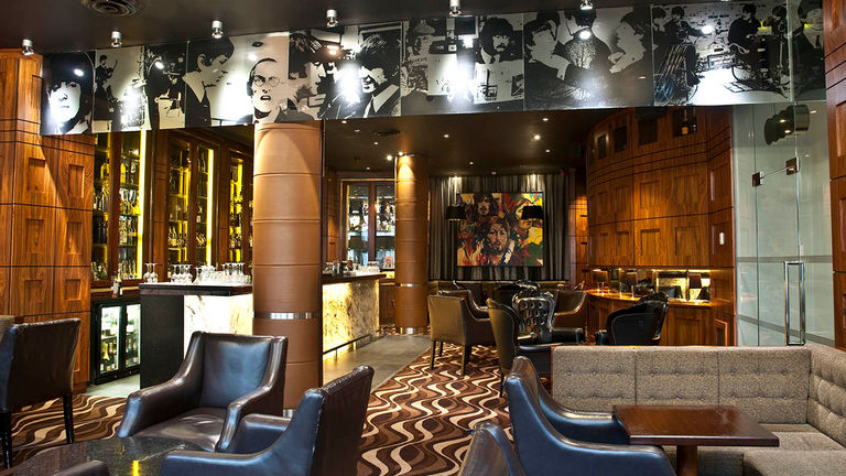 Guests can listen to live music at Bar Four.