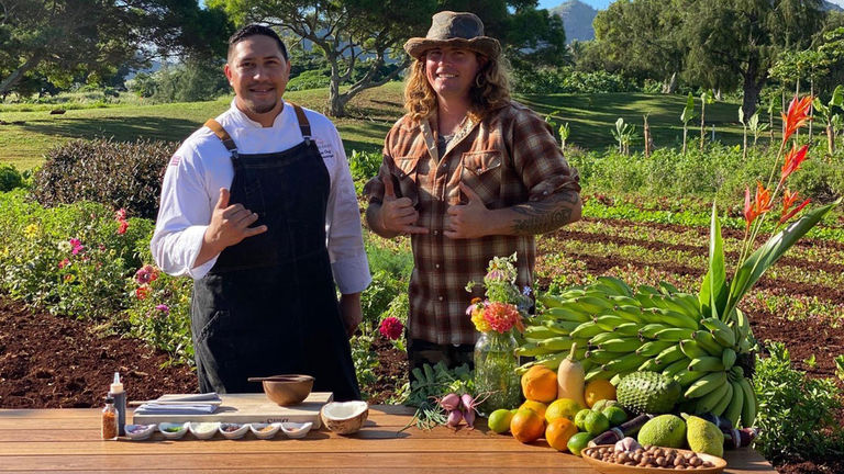 Chef Zach Cummings (left) cooks with food grown by farmer Cody Meyer (right).