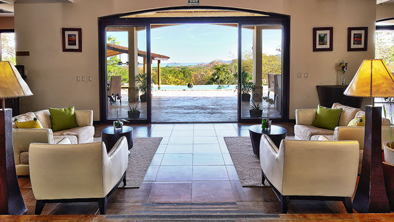 The lobby opens to the dining area by the pool. // © 2015 Villa Buena Onda