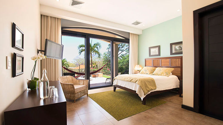 """The """"Poro Poro"""" room with a pool view // © 2015 Villa Buena Onda"""