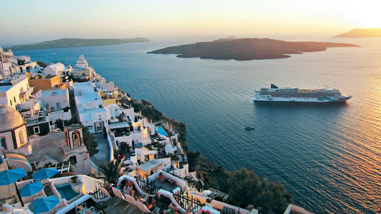 Norwegian Cruise Line has seen a drop in North American customers for its European cruises such as this one off the coast of Santorini.