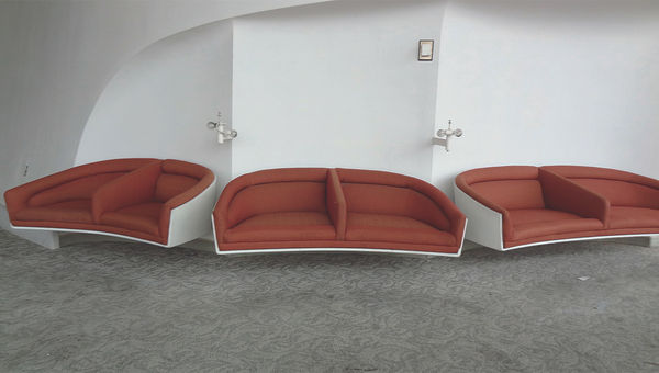Custom-designed Charles Eames furniture in the former first-class lounge of the TWA Flight Center.
