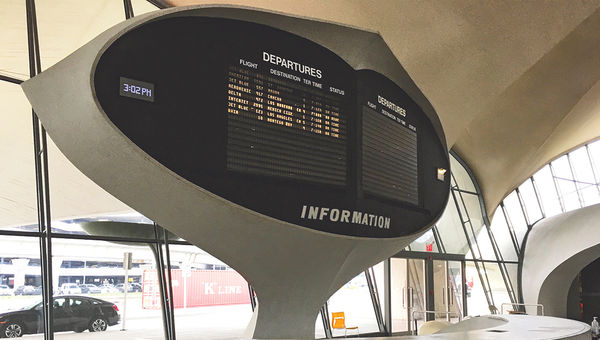 The Flight Center's departures and arrivals information board.