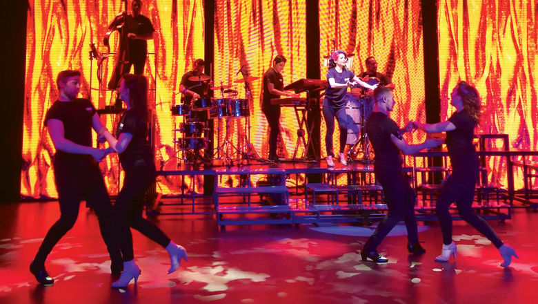 """Dancers and musicians perform in """"Amor Cubano"""" at the opening of Carnival Cruise Line's new rehearsal studio in Davie, Fla."""