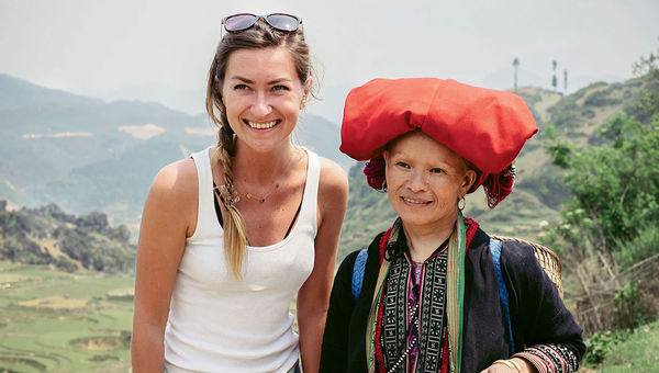 """Visit.org sends """"ambassadors"""" to vet its partner nonprofit programs. Here one of its ambassadors meets with a member of Sapa O'Chau, a group that organizes responsible treks and homestays in Vietnam."""