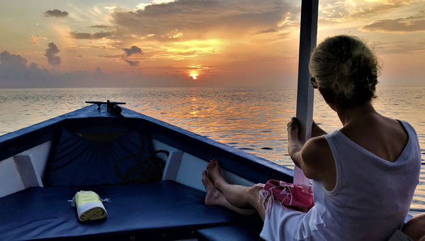 A guest at Bawah Reserve takes in the view on the Six Island Sunset Cruise.