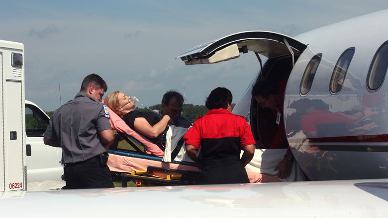 A patient entering a plane for medical air transport.