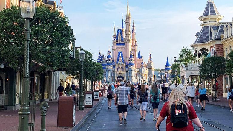 Magic Kingdom guests walking down Main Street USA.