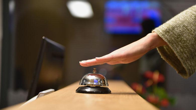 Hotel front desk [Credit: dotshock/Shutterstock.com]