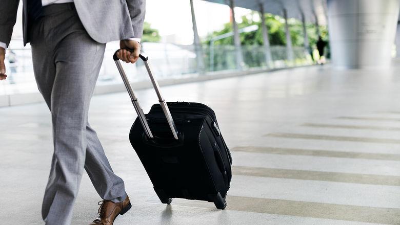 Business traveler [Credit: Rawpixel.com/Shutterstock.com]