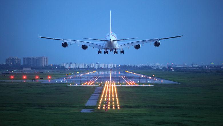 Airplane airport tarmac runway [Credit: potowizard/Shutterstock.com]
