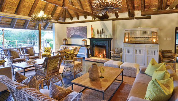 """The deck lounge area at the Lobengula Lodge, the Shamwari Game Reserve's most recently renovated lodge with a look drawing inspiration from a traditional African village that """"creates a tranquil environment by means of the decor,"""" according to Shamwari general manager Joe Cloete."""