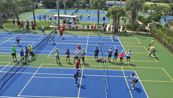 Club Med's tennis courts can be converted for pickleball to accommodate group bookings. A recent group at Club Med Sandpiper Bay making use of 20 pickleball courts.