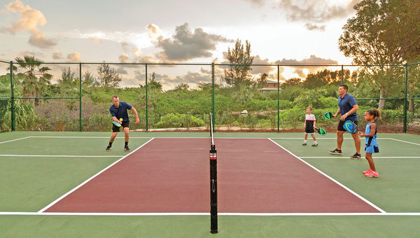 The Ritz-Carlton, Grand Cayman promotes pickleball as a family-friendly activity.