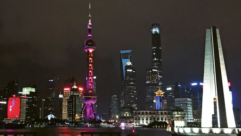 The nighttime view of Shanghai's Pudong district from the Bund waterfront area.