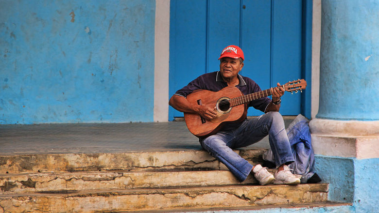 A Cuban guitarist. Covid-era rules, safety considerations and political rollbacks have made it difficult for Cuba tourism.
