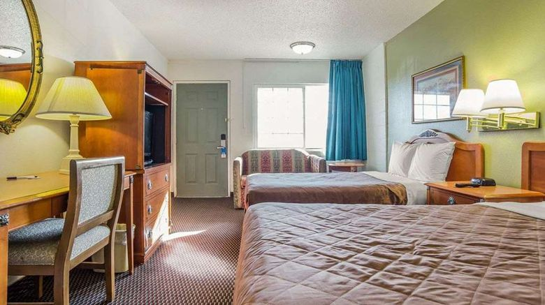 """<b>Rodeway Inn & Suites Room</b>. Images powered by <a href=""""https://iceportal.shijigroup.com/"""" title=""""IcePortal"""" target=""""_blank"""">IcePortal</a>."""