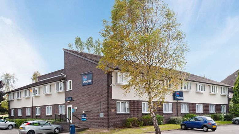 """Travelodge Chester Warrington Road Hotel Exterior. Images powered by <a href=""""http://web.iceportal.com"""" target=""""_blank"""" rel=""""noopener"""">Ice Portal</a>."""